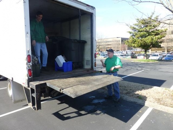 Michael Deinert (right) and Van Williams load up the truck on their Monday route through Maryland Farms.